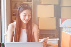 Young asian women entrepreneur working in a home Stock Photo
