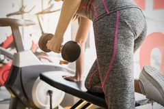 Young asian women lifting dumbbell in sport gym Royalty Free Stock Photography