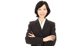 Young Asian women link arms Royalty Free Stock Photos