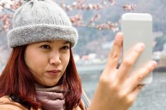 Young asian women are looking at her cellphone Stock Photos