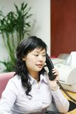Young asian women with phone. Young asian women working  with phone in office Stock Photography