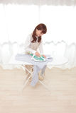 Young Asian women to the ironing stock image