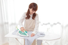 Young Asian women to the ironing Royalty Free Stock Image