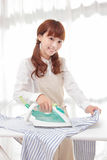 Young Asian women to the ironing Stock Photo