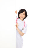 Young Asian women in white coats and white board. Beautiful young japanese woman in white coats and white board Royalty Free Stock Photo