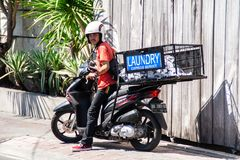 Young asian working as a laundry delivery guy in Bali stock images