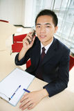 Young asian working in office Stock Image