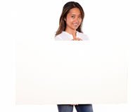 Young asiatic woman holding a white card Royalty Free Stock Images