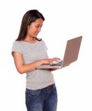 Young asiatic woman using her laptop computer Stock Images