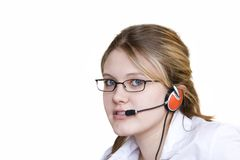 Young assistant. Young woman with head set taking your calls stock image