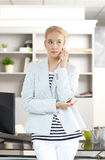 Young assistant with mobile Royalty Free Stock Photos