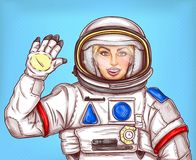 Young astronaut girl in a space suit waving her hand. Sends a greeting on a blue background. Pop art cartoon vector illustration Stock Photography