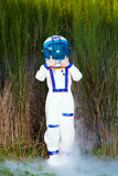 Young astronaut giving two thumbs up Stock Image