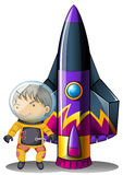 A young astronaut beside the rocket Royalty Free Stock Photography