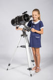 Young astronomer sets up a telescope and looked into the frame Royalty Free Stock Photos