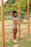 Young athlete african woman doing stretching Royalty Free Stock Photos