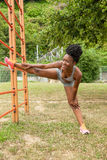 Young athlete african woman doing stretching Stock Images