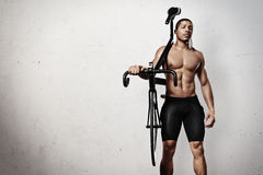 Young athlete with bicycle Stock Images