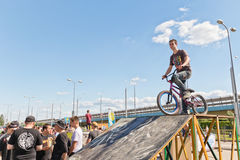 Young athlete on BMX bike is on the ramp ready to jump. VOLGOGRAD - MAY 27:  Young athlete on BMX bike is on the ramp ready to jump. May 27, 2017 in Volgograd Stock Photo