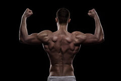 Young athlete bodybuilder from back Royalty Free Stock Photo