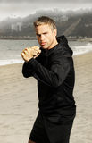 Young athlete boxer at beach Stock Photo