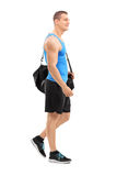 Young athlete carrying sports bag Stock Photos