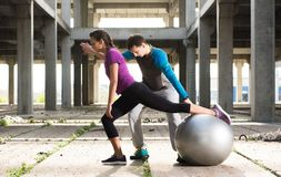 Free Young Athlete Couple Doing Exercise In An Old Abandoned Buildin Royalty Free Stock Photography - 105939277