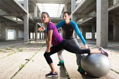 Free Young Athlete Couple Doing Exercise In An Old Abandoned Buildin Stock Photo - 105939410