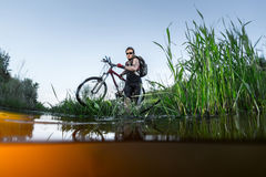 Young athlete crossing the river Stock Image