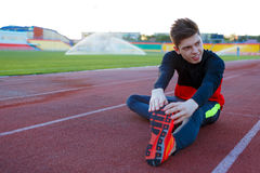 Young athlete doing an exercise in training Stock Photos