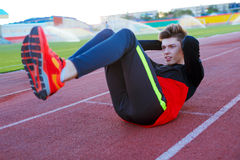 Young athlete doing an exercise in training Royalty Free Stock Photo