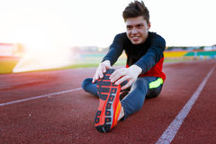Young athlete doing an exercise in training Royalty Free Stock Photography