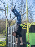 Young Athlete doing a Hand Stand On Parallel Bars In An Outdoor Gym stock photo