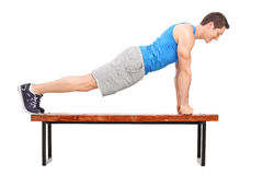 Young athlete doing push-ups on a bench Stock Image