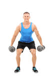 Young athlete exercising with two barbells Royalty Free Stock Photos