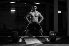 Young Athlete Getting Ready for Weight Lifting Training. Athlete in the Gym Is Prepared to Perform an Exercise Deadlift stock photos