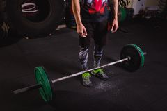 Young athlete getting ready for weight lifting training. Bodybuilders workout with bar Royalty Free Stock Photography