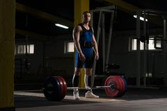 Young Athlete Getting Ready for Weight Lifting Training. Athlete in the Gym Is Prepared to Perform an Exercise Deadlift royalty free stock images