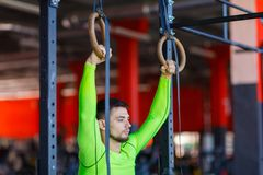 Young athlete with gymnastic rings in the gym. royalty free stock photography
