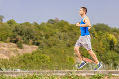 Young athlete jogging outdoors on a beautiful day Royalty Free Stock Photo