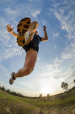 Young athlete jumps while running Royalty Free Stock Images