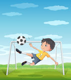 A young athlete kicking the soccer ball Stock Image