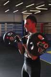 Young athlete lift bar on ring background. Vertical view Stock Photos