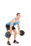 Young athlete lifting a weight. Full length portrait of a young athlete lifting a weight isolated on white background Stock Photos