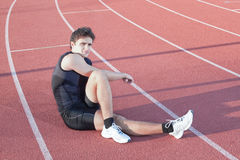 A young athlete makes stretch. Royalty Free Stock Photos