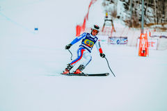 Young athlete male skier after finish of race downhill from mountains during Russian Cup in alpine skiing Royalty Free Stock Images