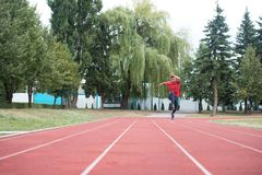 Young Male Athlete Running on Track. Young Athlete Man Running on Track In Park Run Athletics Race Stock Photography