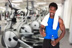 Young athlete man showing thumb up gesture at gym Stock Photos