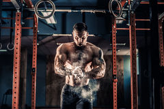 Young athlete practicing crossfit training. Strong muscular man preparing for workout in crossfit gym. Workout lifestyle concept. Young athlete practicing royalty free stock image