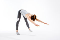 Young athlete practicing in yoga royalty free stock photos